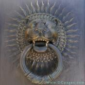 Bronze lion door knocker at the entrance to the House of the Temple.