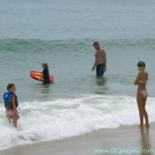 Ocean City - This family is enjoying their day at the beach. The father is teaching the youngest how to boogie board.