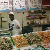 Sellers display fish attractively to lure customers.