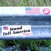 Visitors placed bumper stickers and wrote messages for the victims of Flight 93 on the guardrail of the road next to the crash site.