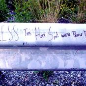 Bless this holy spot where people died written on guard rail.