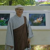 Venerable SungHyo Sunim Stands Next to His Favorite Photograph