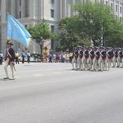 Colonial soldiers marching by