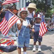Children displaying their patriotic colors
