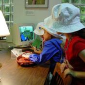 Children learning on a computer in one the multiple programs for youngsters